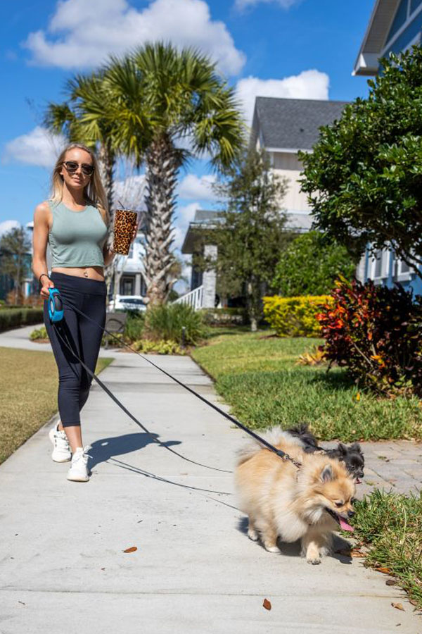 Blonde girl walking dog using Leash Lock