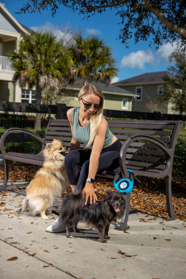 Blonde girl using Leash Lock for two dogs